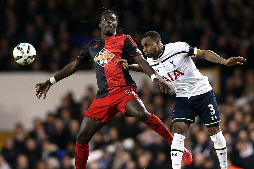 Tottenham's Danny Rose (right)competes for the ballwith Swansea's Bafetimbi Gomis during their match at the Barclays Premier League in White Hart Lane on March 4, 2015. Swansea City striker Bafetimbi Gomis moved to reassure concerned onlo