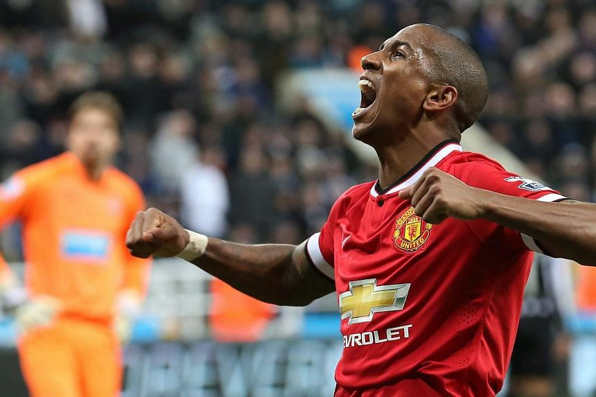 Manchester United's Ashley Young celebrating his winning goal against Newcastle United at St James' Park on March 4, 2015. -- PHOTO: EPA