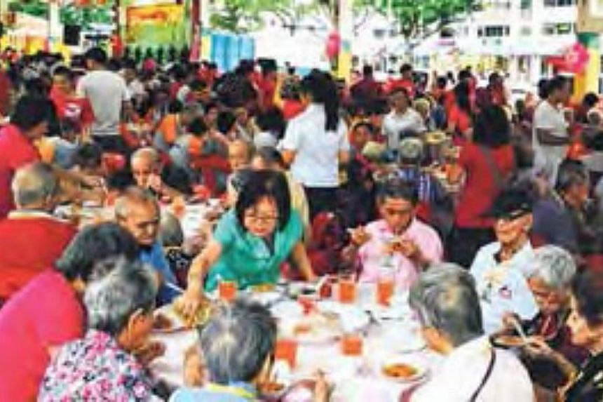 Man Fut Tong Welfare Society, which organised a Chinese New Year dinner for 1,100 seniors on Sunday, received 300 tins. -- PHOTO: FOOD BANK SINGAPORE S