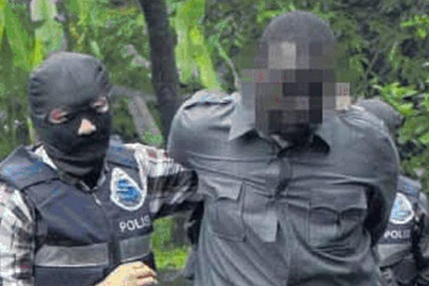 A Somalian man believed to be a member of a terrorist group known as Al-Shabaab being detained by officers from the Bukit Aman Special Branch Counter Terrorism Unit. Malaysia's new anti-terrorism law will give authorities power to detain terror suspe