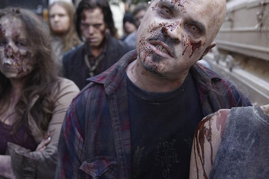 Television still of popular US TV show The Walking Dead. A study by Cornell University in New York state suggests that Americans living in the Rockies stand a better chance of dodging a zombie apocalypse than their urban counterparts. -- PHOTO: FOX I