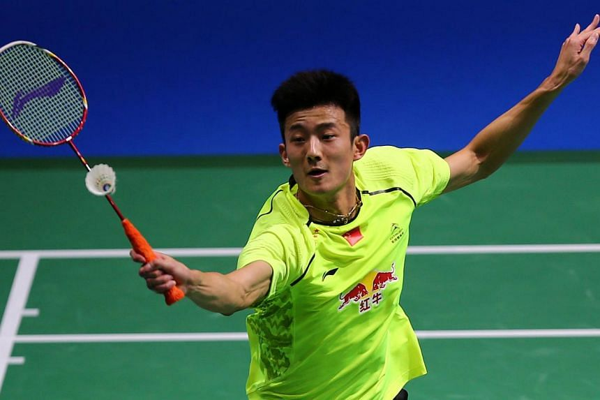 World champion Chen Long - seen here (above) in action in Dubai last year - avoided a potential first-round exit at the All-England Championships on Wednesday and blamed an uncomfortable pillow for a sluggish start to his campaign. -- PHOTO: AFP