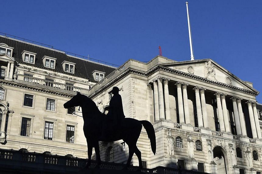 The Bank of England, seen with a statue in the foreground, in London on Dec 16, 2014. -- PHOTO: REUTERS