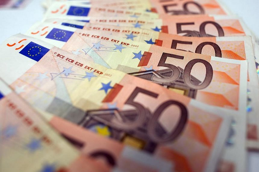 The euro wallowed at its lowest in over 11 years against the greenback early on Thursday, having suffered a big setback as investors waited for the European Central Bank to announce more details of its massive bond-buying program. -- PHOTO: BLOOMBERG