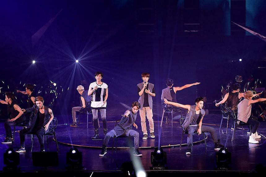 K-pop group Exo performing at their first concert in Singapore on Aug 23, 2014, at the Singapore Indoor Stadium. -- PHOTO: NP FILE
