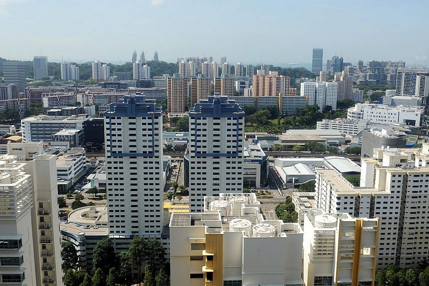 Resale prices for Housing Board flats were back to their downward trend in February as predicted by property analysts, slipping 0.6 per cent compared with January, and bringing prices 5.7 per cent lower than a year ago. -- PHOTO: ST