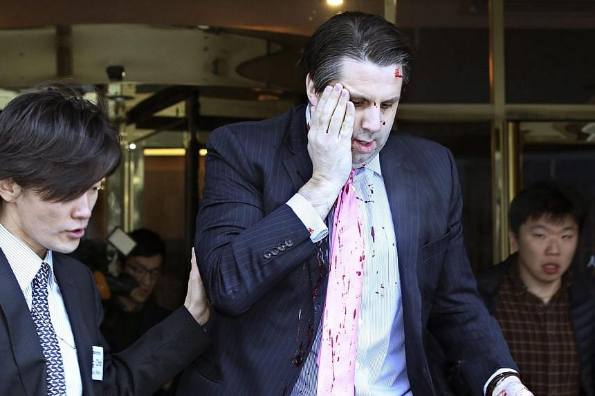 US Ambassador to South Korea Mark Lippert leaving Sejong Centre for Performing Arts in downtown Seoul on March 5, 2015, after being attacked by a knife-wielding assailant. -- PHOTO: EPA