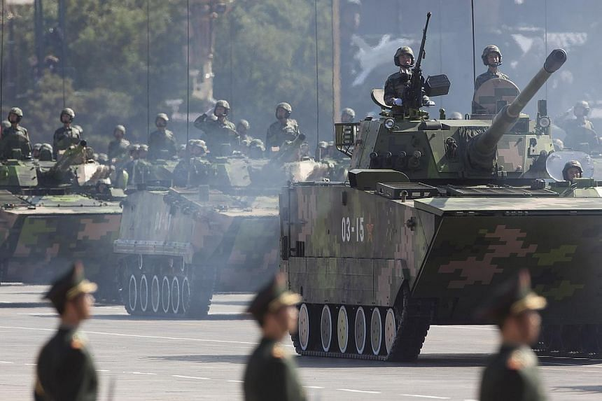 Chinese People's Liberation Army tanks move down Changan Ave. during a military parade in Beijing, China. Amid a slowing economy, China has raised its defence budget by 10.1 per cent to 887 billion yuan (S$193.4 billion) this year, keeping its nearly