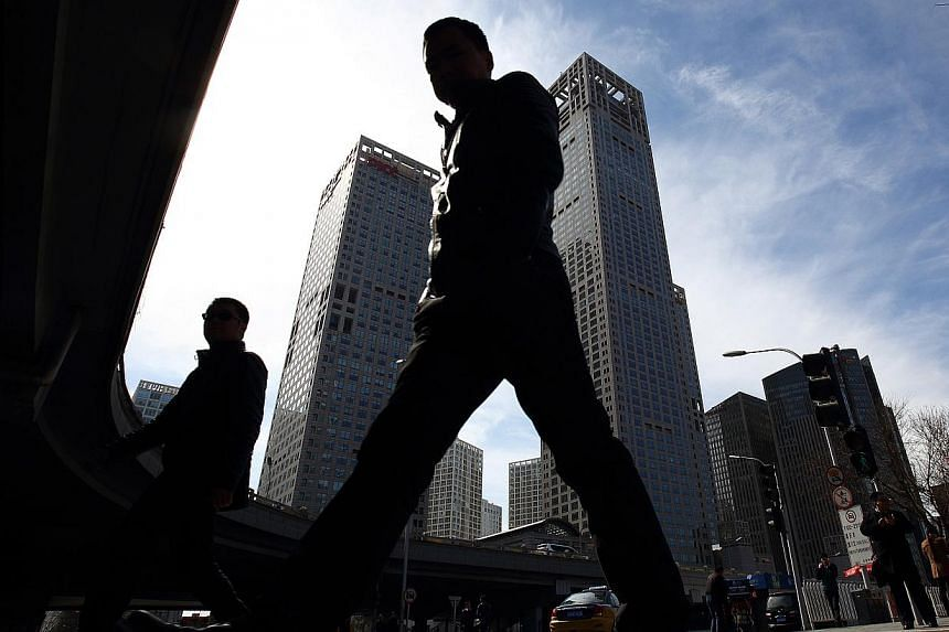 Pedestrians walk in the central business district of Beijing, China, on March 4, 2015.
