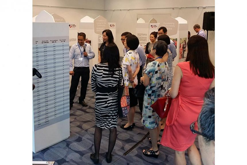 Visitors looking at the displays at the Home Nursing Foundation's first-ever travelling exhibition commemorating its past, at the Central Public Library on Thursday, March 5, 2015. The exhibition was done in partnership with the National Library Boar