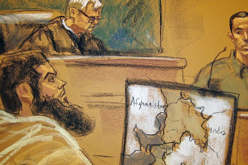 Abid Naseer (left) listens to testimony from Najibullah Zazi (right) as US District Judge Raymond Dearie looks on in this courtroom sketch in Brooklyn, New York Feb 17, 2015. Naseerwas convicted on Wednesday on US charges of participating in an