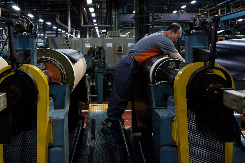 An employee at work on the production line of a tyre company in Geumsan, South Korea, on March 2, 2015.South Korea's legion of older workers has helped keep the jobless rate low but has exacerbated record low employment among the young - less t
