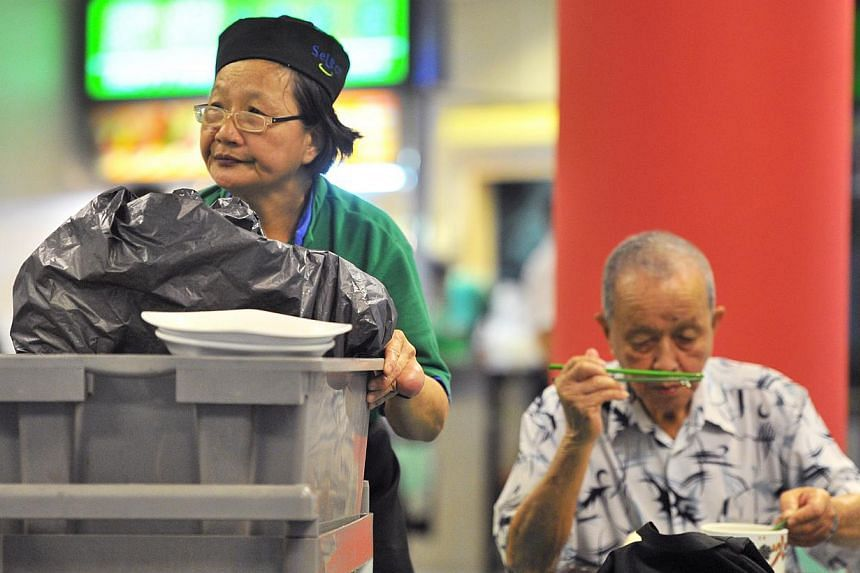 More than seven in 10 of nearly 100,000 women aged 60 and above who worked last year earned less than $2,000 per month, a Labour Force Survey shows. -- PHOTO: ST FILE