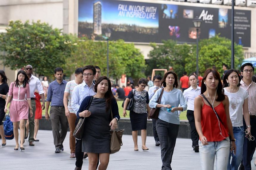 Even as more Singaporean women become wage earners, our Asian values-based society has to become more accepting of modern life choices - that men can stay at home and be the primary caregivers of families. -- PHOTO: ST FILE