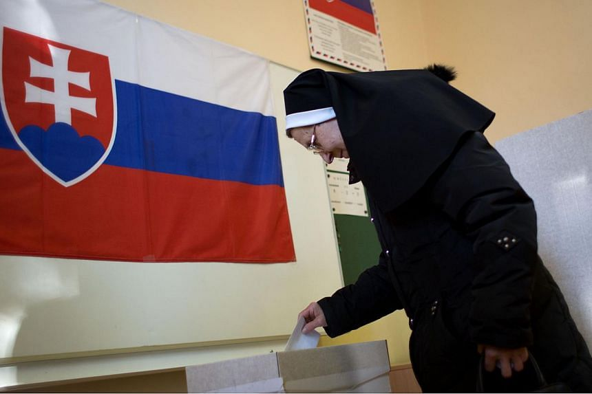 A woman casting her ballot during a referendum about same-sex marriage, a ban on gay and lesbian couples from adopting and sex education classes in schools, in Slovakia on Feb 7, 2015. Globalisation has served to curtail rather than expand school-bas