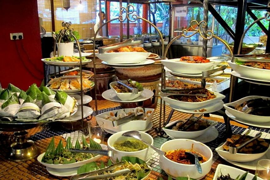 Malaysia has a thriving food scene as diverse as Singapore's but none of its restaurants has made the cut. That is inexplicable. Above, a buffet spread at Rebung Restaurant in Kuala Lumpur.