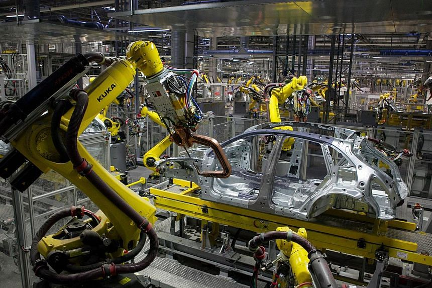 The first threat is that skills-biased technological change, such as robotics, favours a more urban and educated workforce and will result in growing unemployment and rising income inequality in emerging markets.-- PHOTO: BLOOMBERG