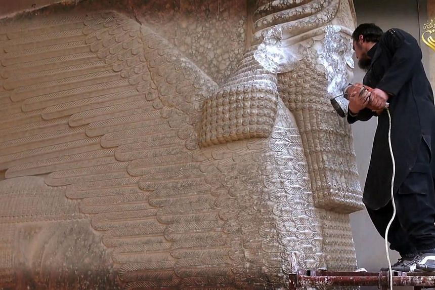 A video reportedly released by the Nineveh branch of ISIS on Feb 25 shows a militant destroying the statue of a lamassu, an Assyrian deity, with a jackhammer in the northern Iraqi governorate of Nineveh. The five-minute video also shows ISIS militant