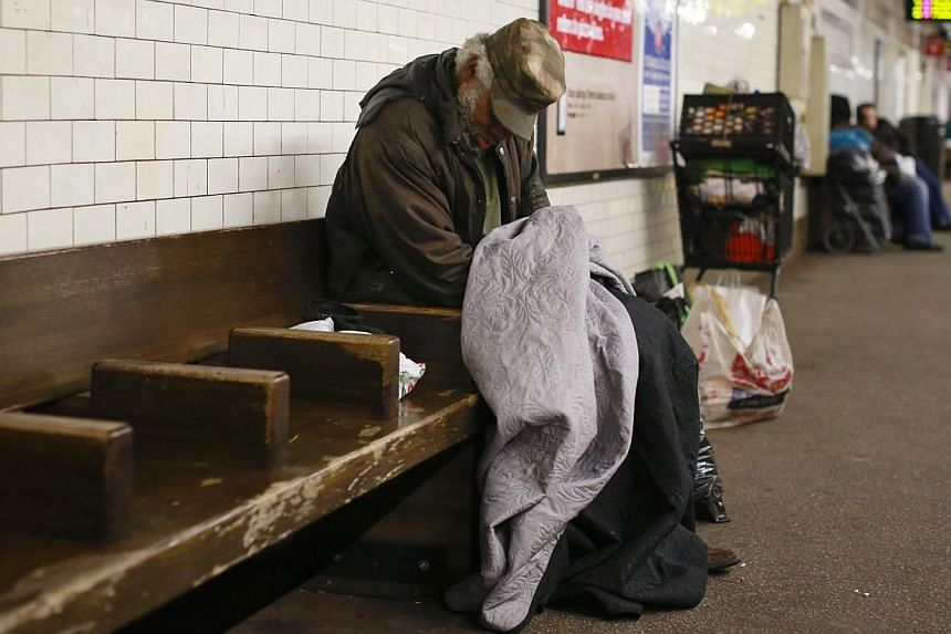 A man sleeping at at the Borough Hall subway station in the Brooklyn borough of New York on Feb 10. -- PHOTO: REUTERS