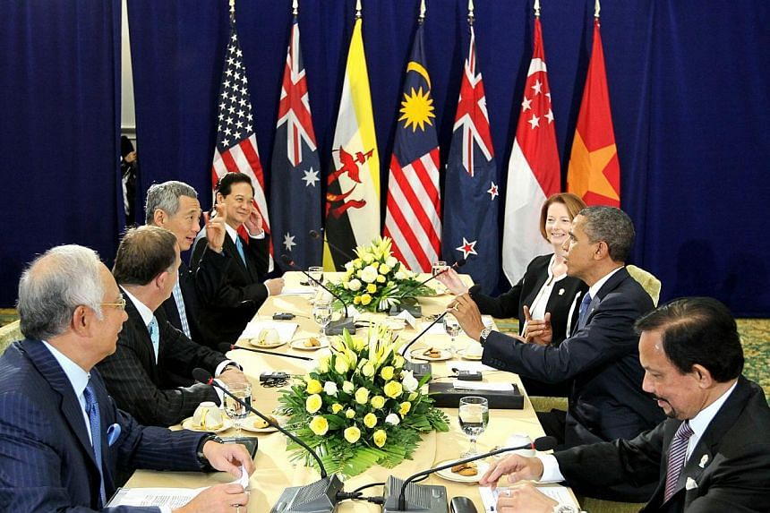 A 2012 photo from Singapore Prime Minister Lee Hsien Loong's Facebook page shows Asia-Pacific leaders in Cambodia discussing the Trans-Pacific Partnership with US President Barack Obama (second from right). -- PHOTO: MINISTRY OF COMMUNICATIONS AND
