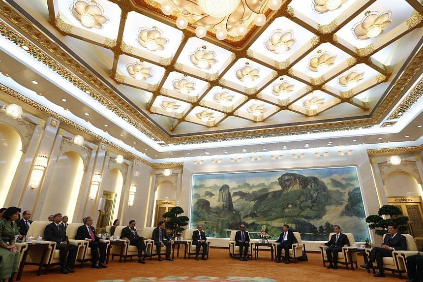 China's President Xi Jinping (fourth right) meets with guests at the Asian Infrastructure Investment Bank (AIIB) launch ceremony at the Great Hall of the People in Beijing in this Oct 24, 2014 file photograph. Britain says it has sought to become a f