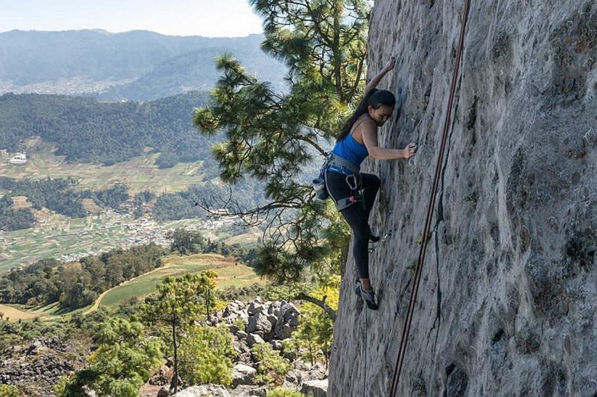 Besides running her businesses, Ms Lim often goes rock climbing.