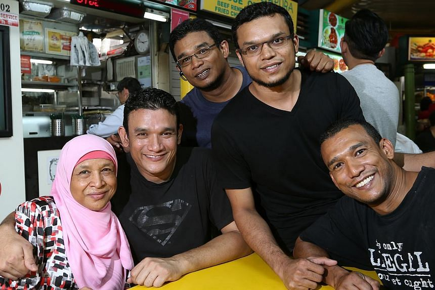 Mr Abdul Malik Hassan (second from left) with his mum Aminah K. Omar, 65; and his brothers (from left) Redzuan Hassan, 41; Ahmat Faisal Hassan, 34; and Mohd Fadzillah Hassan, 38.