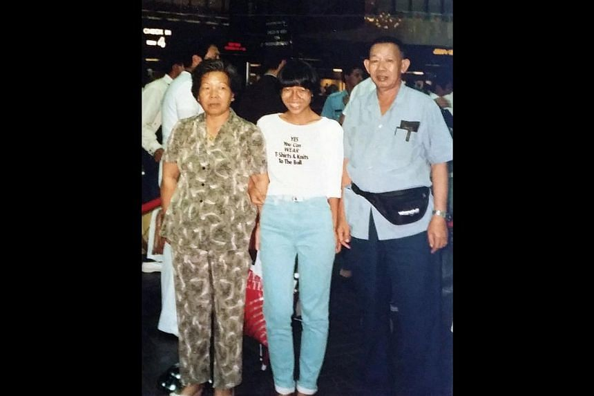 Ms Chua Mui Hoong with her parents at Changi Airport before she took her first plane ride – to Cambridge University to take up a government scholarship. -- PHOTO: COURTESY OF CHUA MUI HOONG