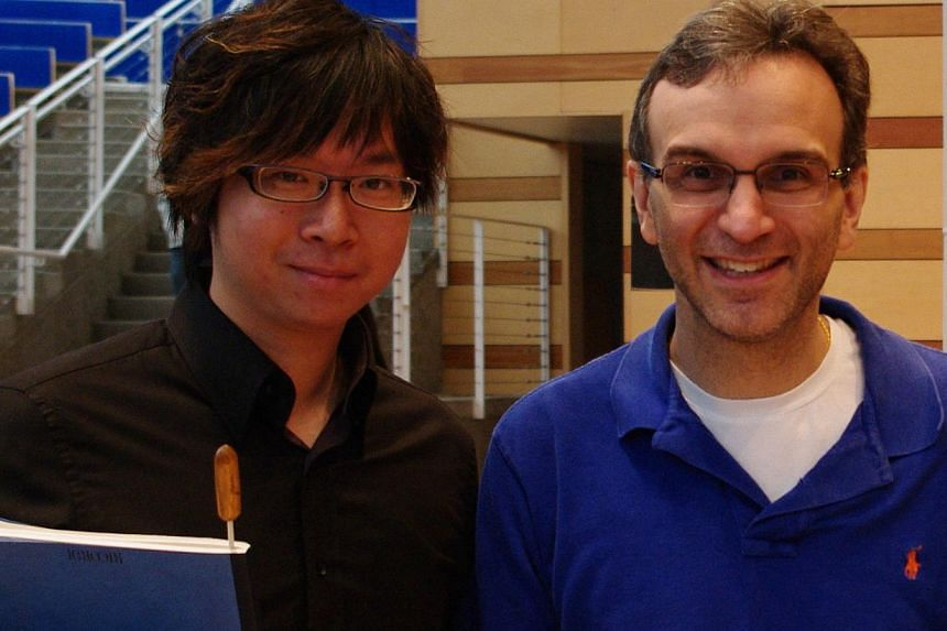 Musician/conductor Wong Kah Chun with violinist Gil Shaham at the Aspen Music Festival in 2011.