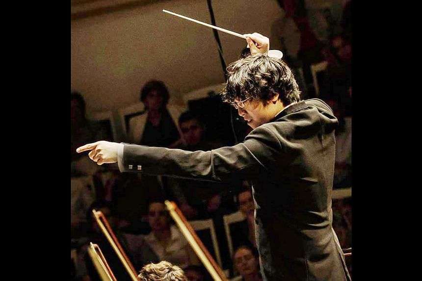 Musician/conductor Wong Kah Chun conducting the Moscow Philharmon.