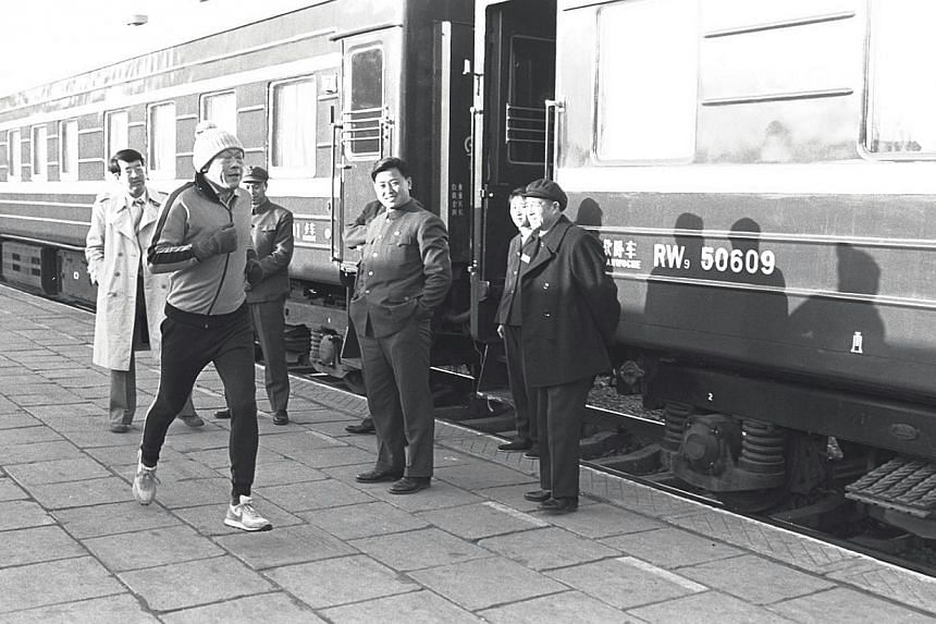 Mr Lee running in Chengde, China, in 1980. He turned to running after a surgeon friend told him that pushing the heart to its limits for as long as possible would improve heart muscle tone and get rid of the feeling of lethargy. -- ST FILE PHOTO