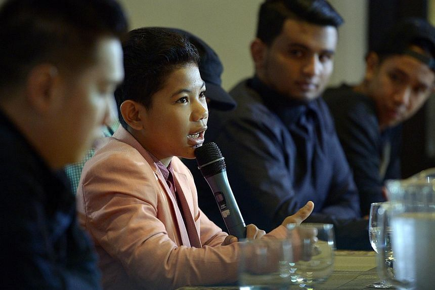 Indonesian child star Tegar Septian speaking at a press conference on Wednesday. His former manager has been arrested by the police here after two reports were made alleging sexual harassment. -- ST PHOTO: DESMOND WEE
