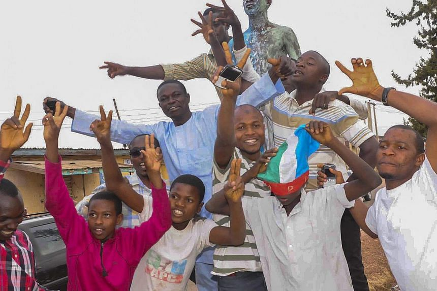 Nigerians celebrating the victory of Mr Muhammadu Buhari in Jos, Nigeria, on March 31, 2015, at the presidential election. -- PHOTO: EPA