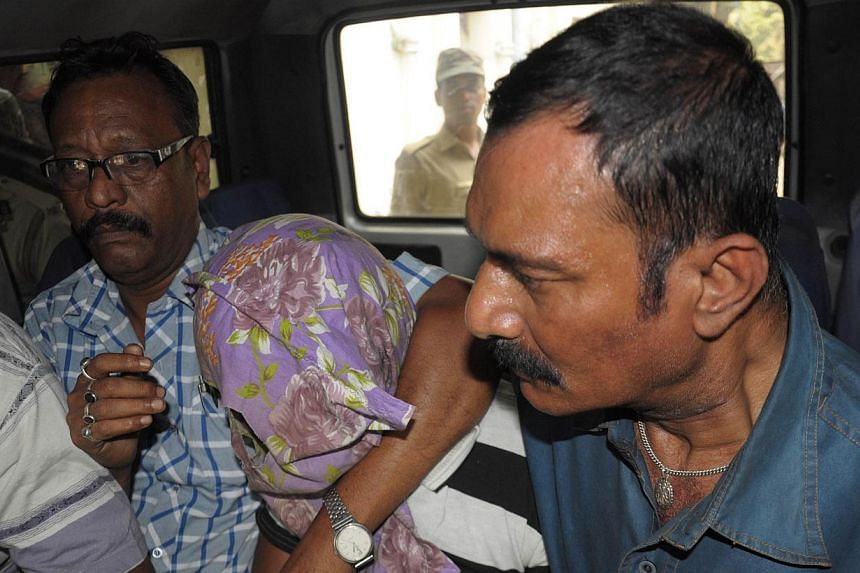 Indian police officials escort suspect Gopal Sarkar (centre) towards a court appearance in Ranaghat on March 27, 2015. The Indian police said on Wednesday, April 1, that they have arrested four Bangladeshi nationals in connection with the rape of an