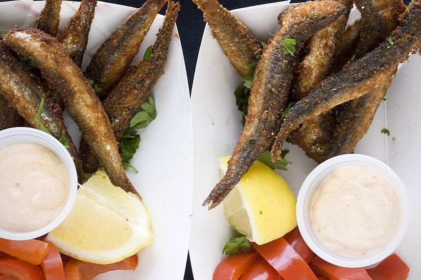 Lightly breaded and fried anchovies (above) are served with lemon, pickled sweet peppers and smoked paprika aioli. -- PHOTO: MAKANSUTRA