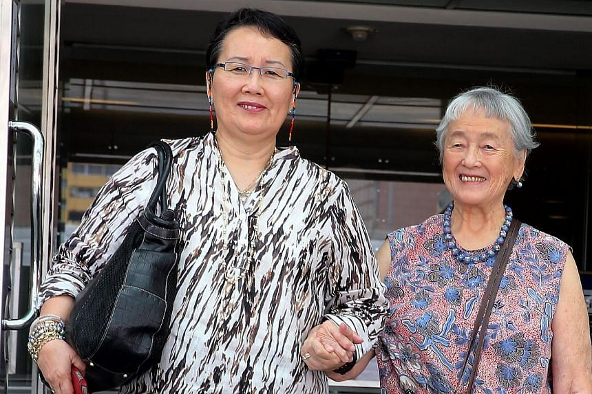 Madam Chung Khin Chun (left) and her niece Hedy Mok (far left) at the Family Justice Courts yesterday. Madam Chung made a new will last December which leaves most of her assets to charity.