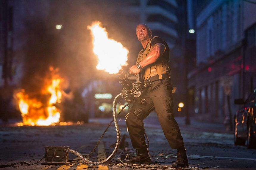 Actor Dwayne Johnson, who joined the Fast & Furious films in the fifth instalment, reprises his role as federal agent Luke Hobbs in Fast & Furious 7. -- PHOTO: UIP