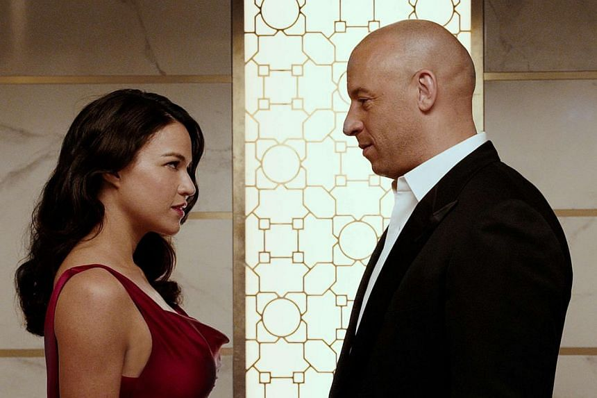 The romance between Letty (Michelle Rodriguez) and Dominic Toretto (Vin Diesel) continues in Fast & Furious 7. -- PHOTO: UIP