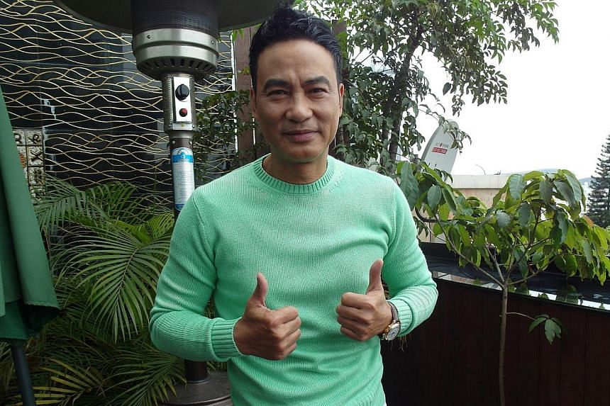 Actor Simon Yam (above) is usually clean-cut and dapper, but he grew a moustache to play a robber in Two Thumbs Up. -- PHOTO: GOLDEN VILLAGE PICTURES