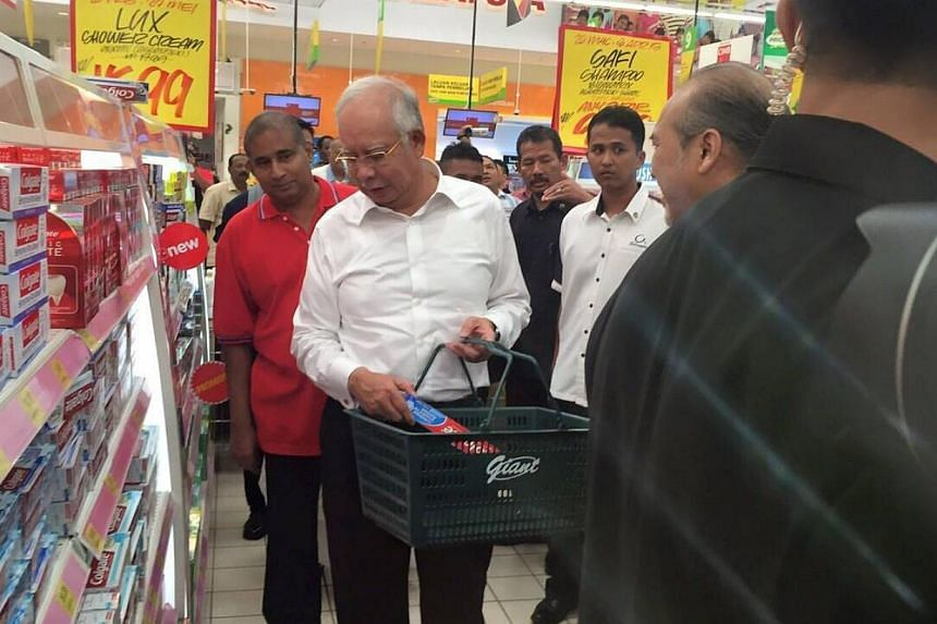 Malaysian Prime Minister Najib Razak went shopping in a supermarket on the first day the country implemented a 6 per cent consumption tax aimed at plugging a leaky tax-collection system. -- PHOTO: NAJIB RAZAK'S FACEBOOK