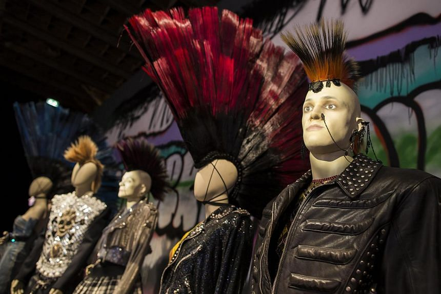 Creations by French fashion designer Jean-Paul Gaultier are displayed as part of the Jean-Paul Gaultier retrospective held at the Grand Palais in Paris, France, 30 March 2015. -- PHOTO: EPA
