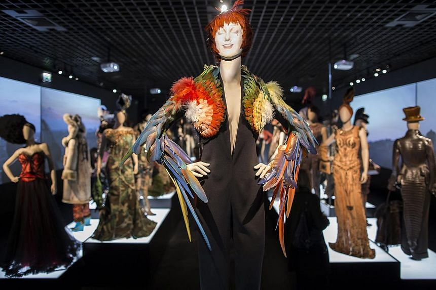 Creations by French fashion designer Jean-Paul Gaultier are displayed as part of the Jean-Paul Gaultier retrospective held at the Grand Palais in Paris, France, 30 March 2015. Started by the Montreal Museum of Fine Arts in 2011, the exhibition which
