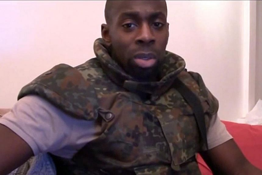 Three men arrested as part of an investigation into the Paris attacks in January in which 17 people were killed are linked toAmedy Coulibaly (above), one of the three Islamist militant gunmen who perpetrated the attacks,the Paris prosecut