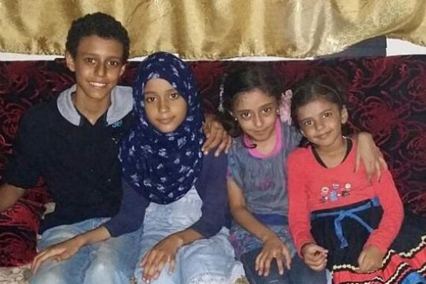 Madam Sherin Fathima Syed Abdul Ravoof's four children. -- PHOTO: THE NEW PAPER