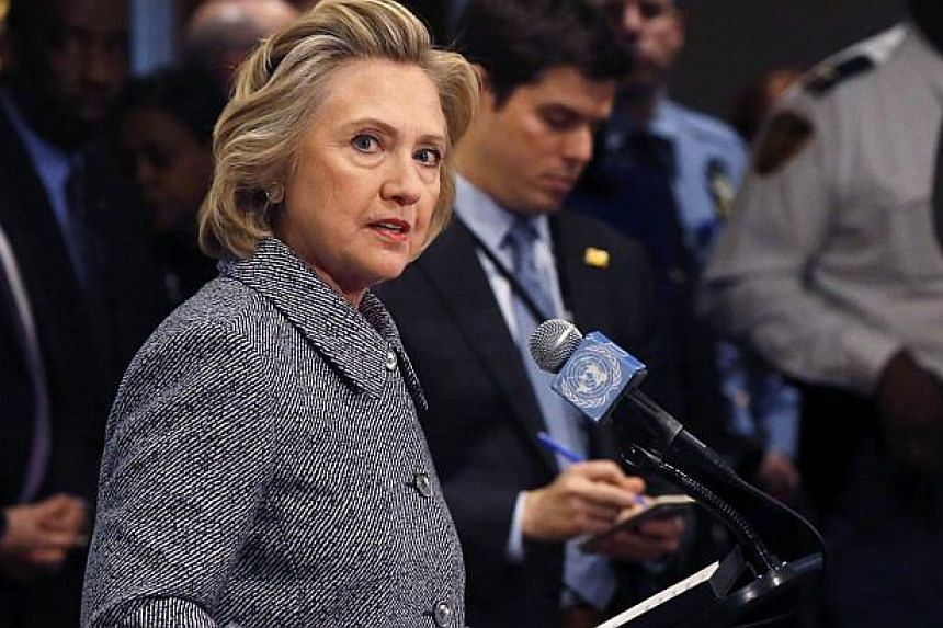 Former US secretary of state Hillary Clinton speaks during a news conference at the United Nations in New York, in this March 10, 2015, file photo. A US congressional panel investigating the 2012 Benghazi attacks called for Hillary Clinton on Tuesday