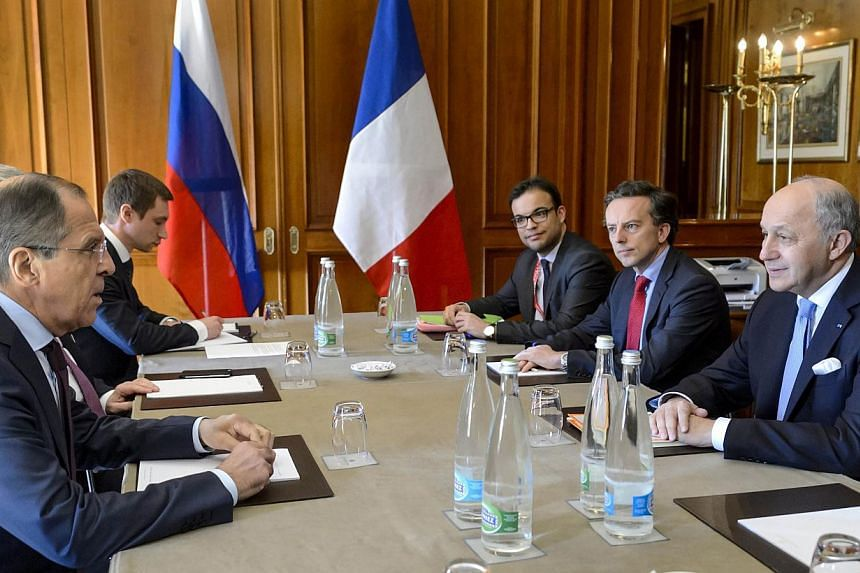 French Foreign Minister Laurent Fabius (right) speaking with his Russian counterpart Sergei Lavrov (left) and their delegations during Iran nuclear talks, on March 30, 2015. Mr Fabiussaid on Wednesday, April 1, that talks between Iran and world