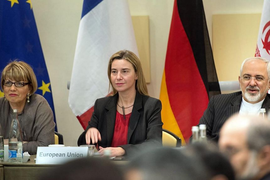 (From left) European Union Political Director Helga Schmid, European Union High Representative Federica Mogherini and Iranian Foreign Minister Javad Zarif wait with others for a meeting with officials from the P5+1, the European Union and Iran in Lau