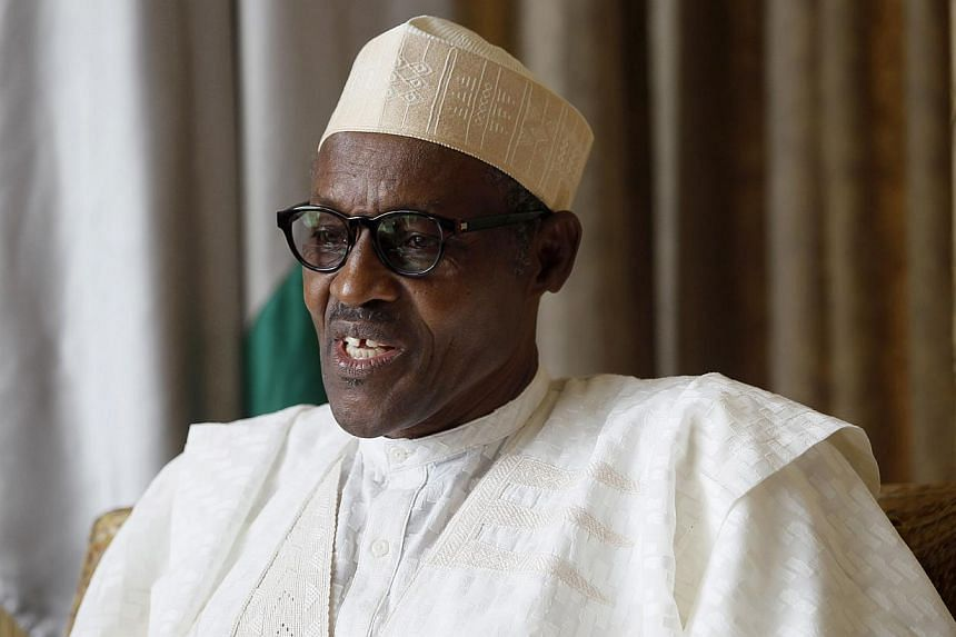Muhammadu Buhari (above), the winner on Tuesday of Nigeria's most closely fought presidential election, had a harsh anti-corruption stance when he was last in power that made him many political enemies in a country where graft is widespread.. -- PHOT