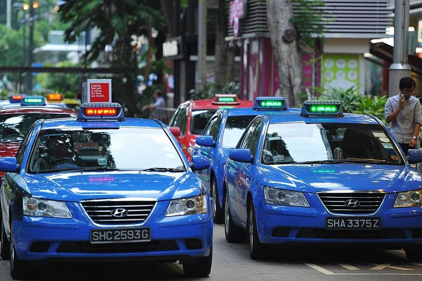 The Public Transport Council (PTC) has responded to concerns that taxi firms might violate the Competition Act by coming together to set the same taxi surcharges. -- ST PHOTO: LIM YAOHUI FOR THE STRAITS TIMES