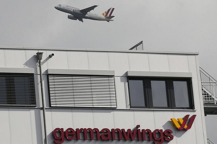 A Germanwings aircraft takes off from Cologne-Bonn airport in front of dark clouds on March 27. -- PHOTO: REUTERS